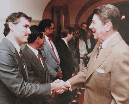 Historian, Doug Wead, shaking hands with, President Ronald Reagan