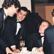 Historian Doug Wead, at a dining table, next to future president, George W. Bush